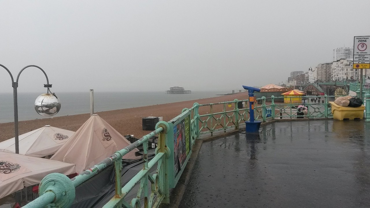 A rain lashed Brighton seafront as storms hit the Hove, Brighton and Worthing areas of Sussex at the start of the morning rush-hour