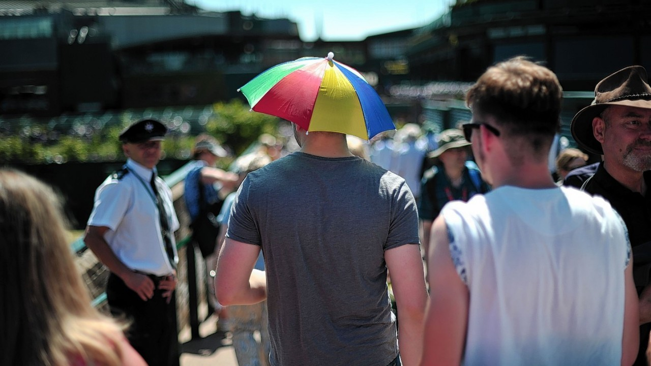 Fans enjoy the sun on Murray Mount during day eleven of the Wimbledon Championships at the All England Lawn Tennis and Croquet Club, Wimbledon.
