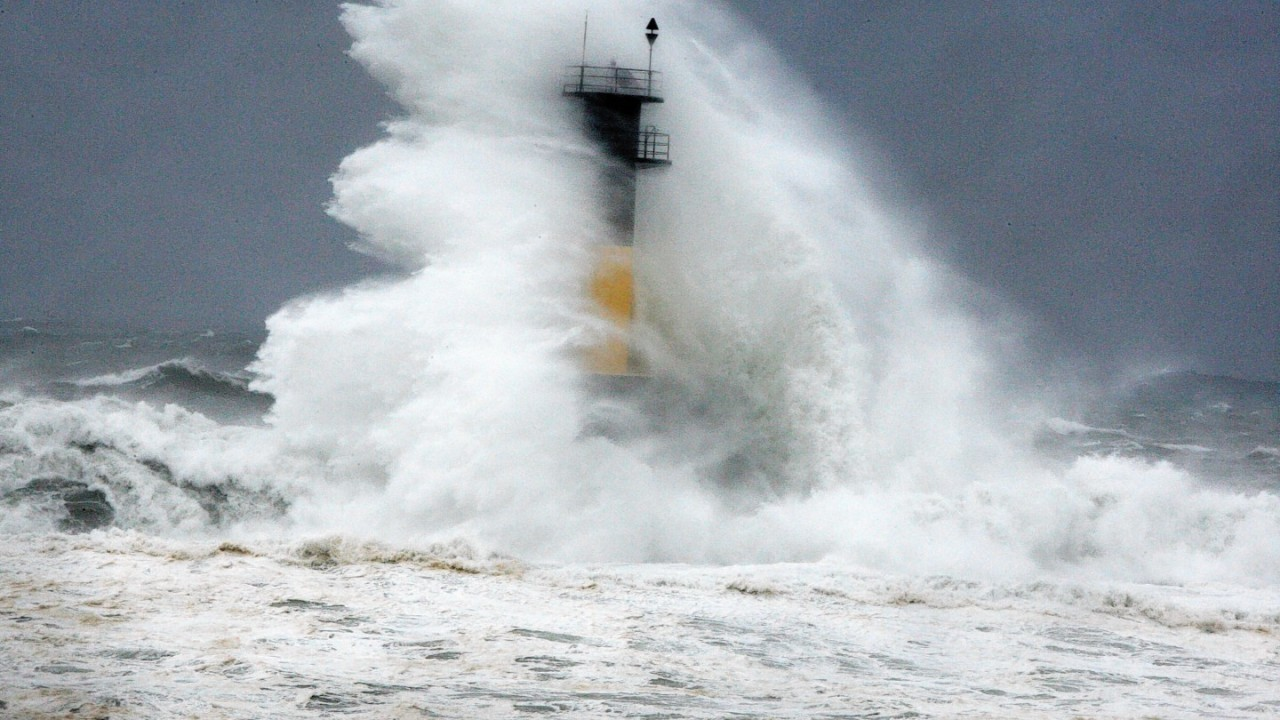 High wave hits a lighthouse as typhoon Neoguri approaches the Korean Peninsula in Seogwipo on Jeju Island , South Korea,