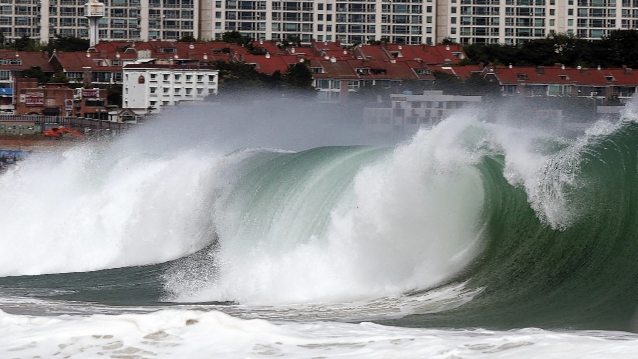 High waves crash over Haeundae Beach in Busan, South Korea, as typhoon Neoguri approaches the Korean Peninsula, Wednesday, July 9, 2014