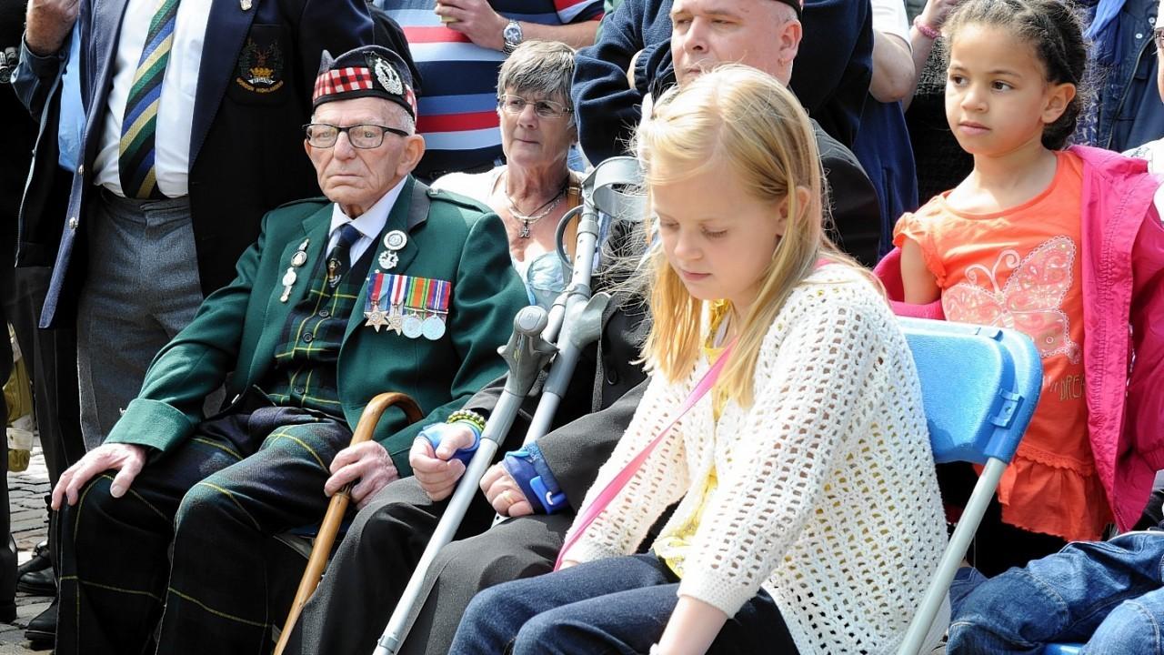 War veterans watch the march