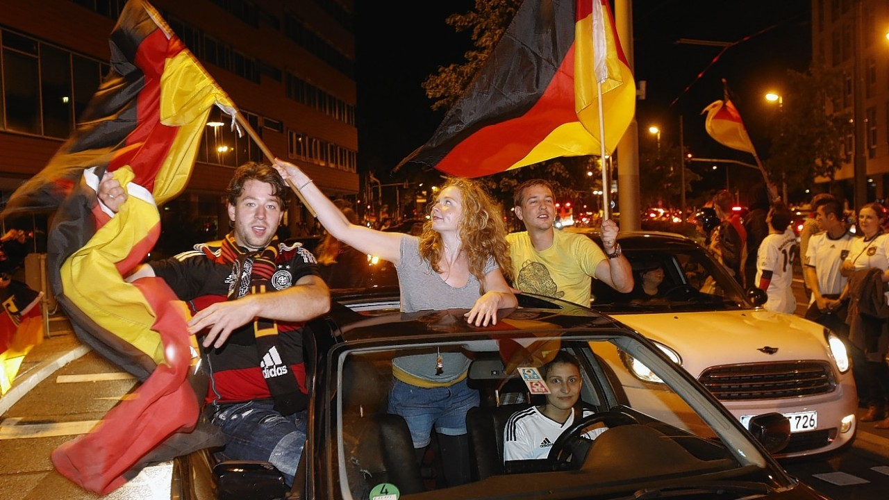 German soccer fans celebrate after the World Cup final between Germany and Argentina in downtown Frankfurt, Germany, early Monday, July 14, 2014
