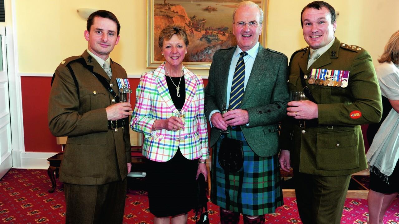 Maj Darren Woods, Jean Royan, Jim Royan, and Capt Stephen Smith.