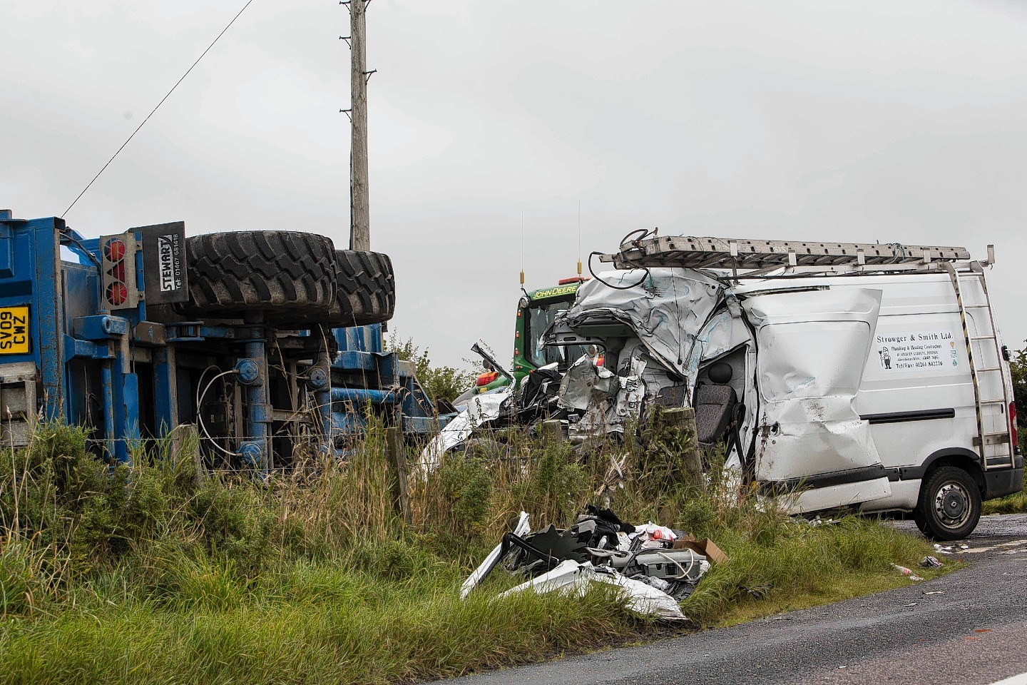 The van and tractor crash on the B9025