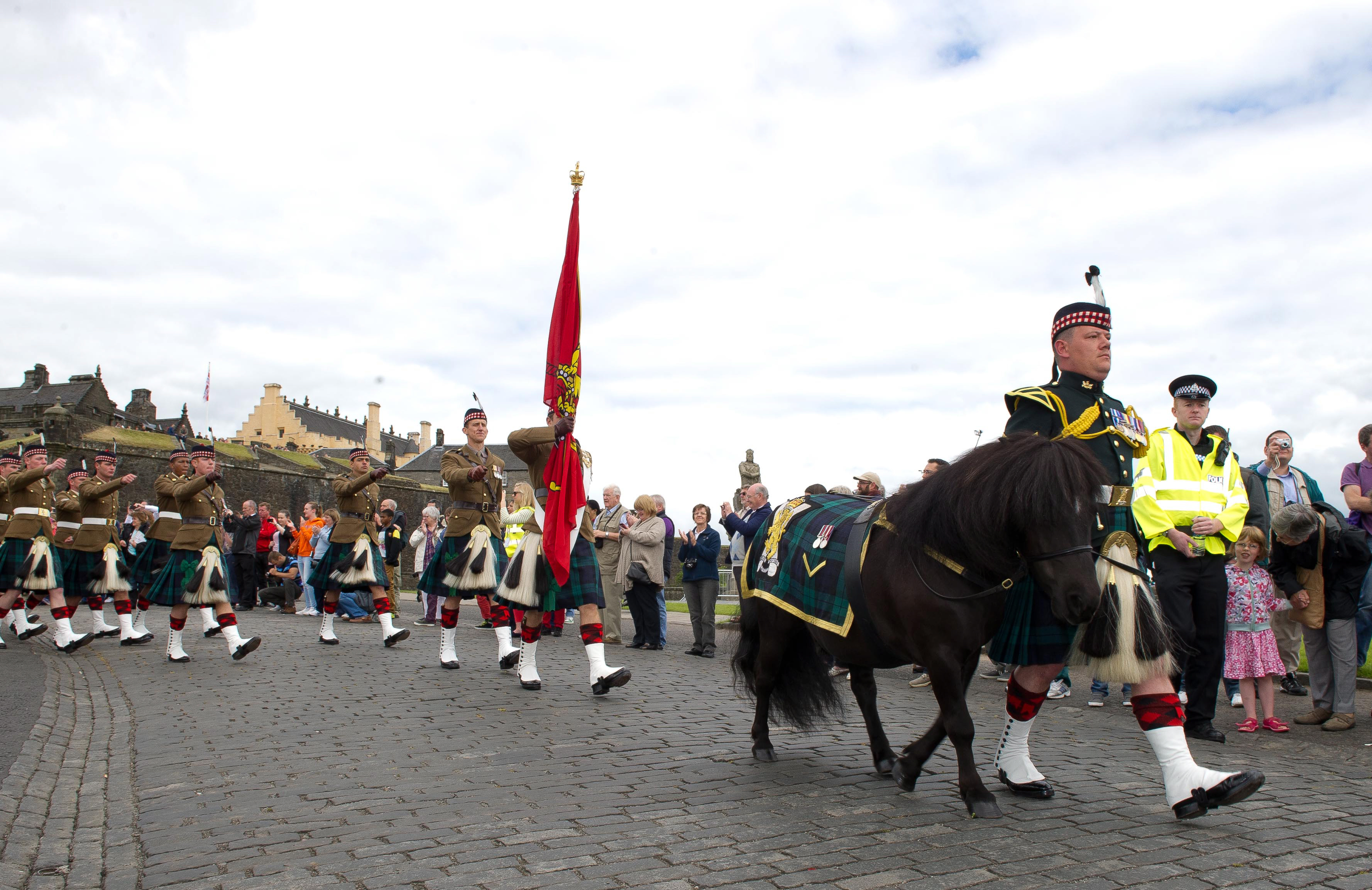 Lance Corporal Cruachan IV leads off the parade of the Royal Regiment of Scotland Armed Forces Day, Stirling, 28 June 2014