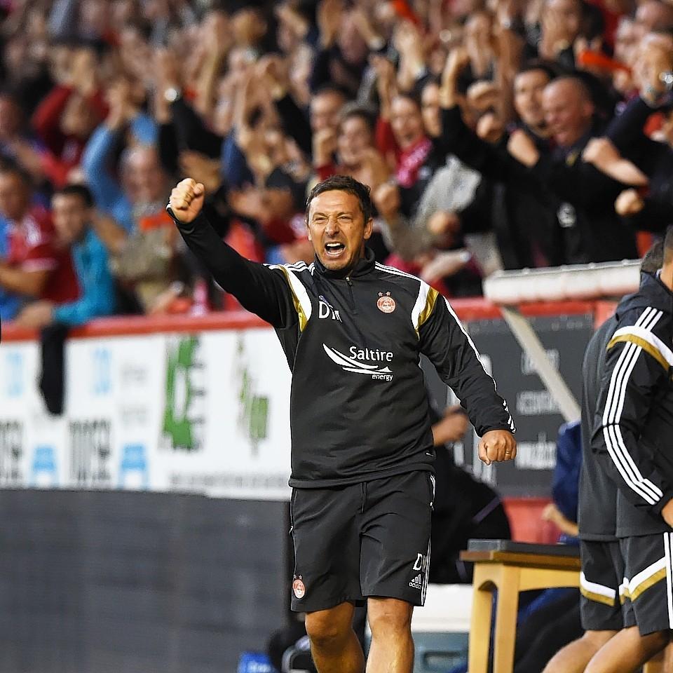 Derek McInnes watches the Dons playing Real Sociedad