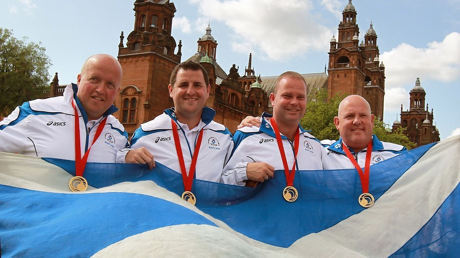 David Peacock (l to r),Neil Speirs, Paul Foster and Alex Marshall with their gold medals after winning against England in the Men's Fours final at Kelvingrove Lawn Bowls Centre, during the 2014 Commonwealth Games in Glasgow.