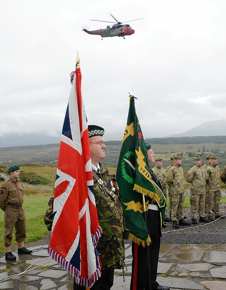 A Royal Navy helicopter performed a flypast at the ceremony