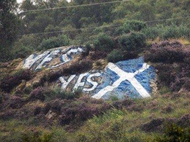 The saltire painted on The Sugar Loaf with yes mesages