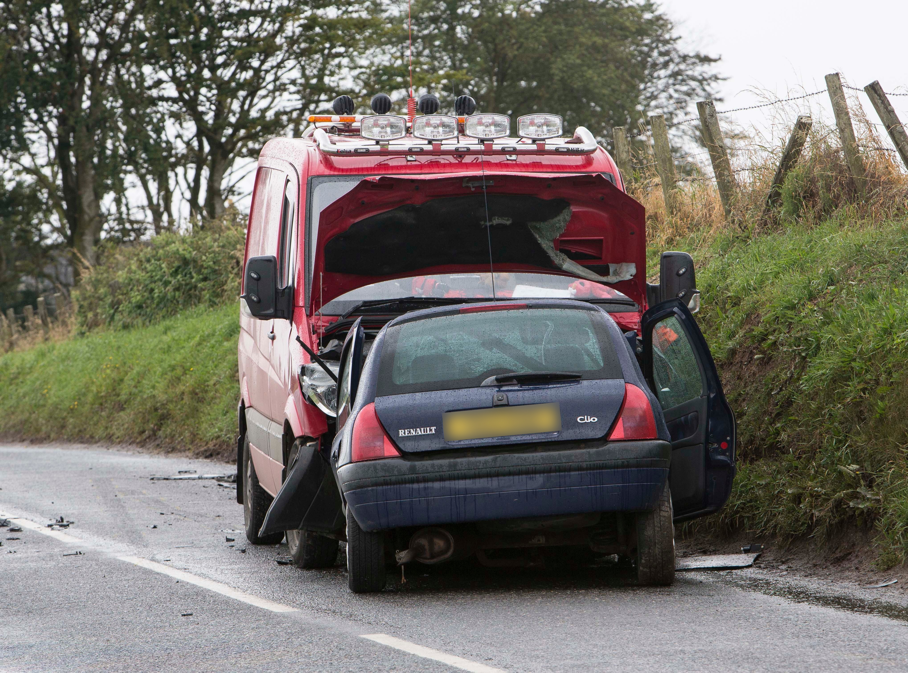 Police attend the scene of a two vehicle accident on the B9015