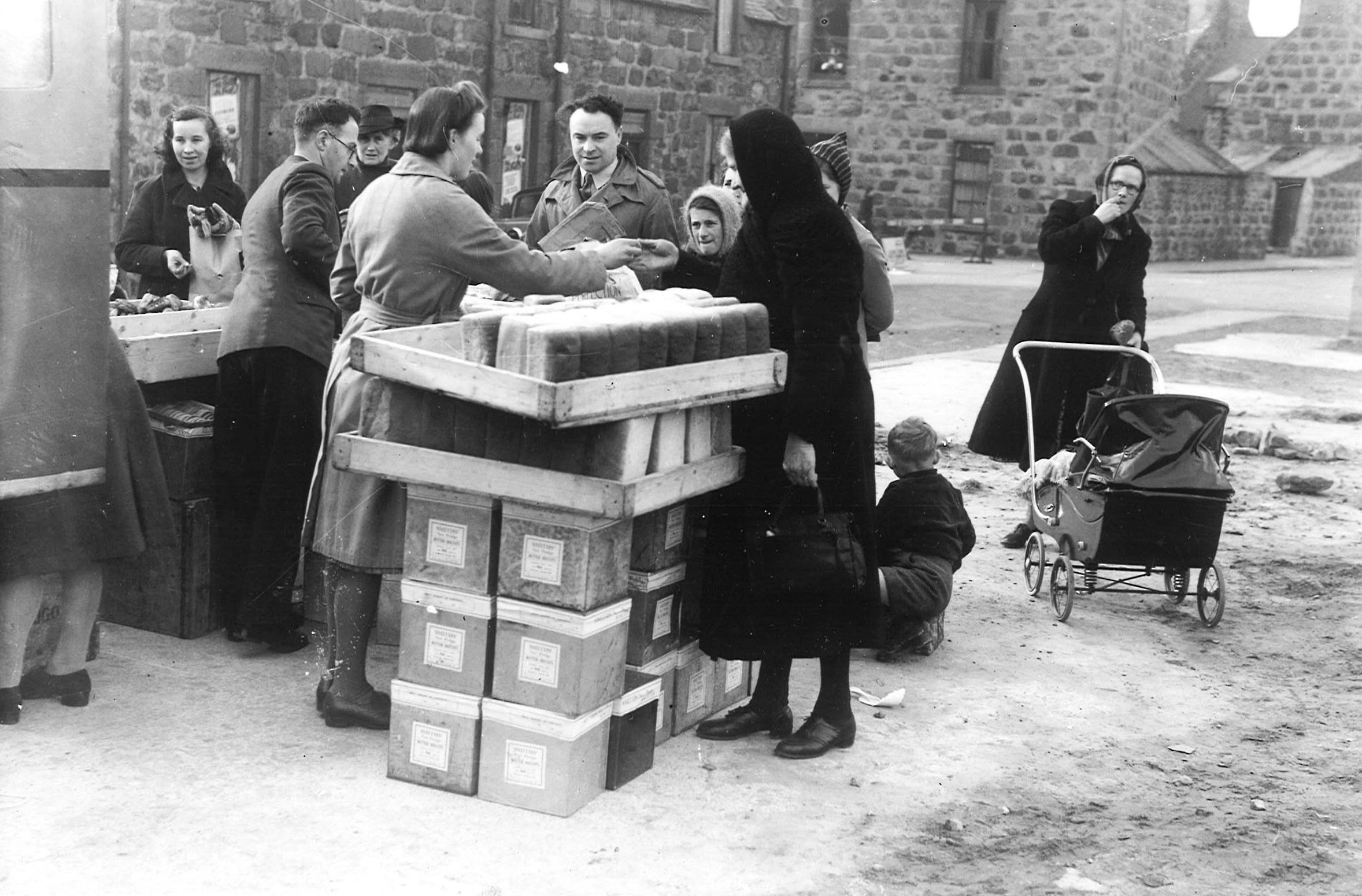 People in Fraserburgh buying bread from a van, September 1941