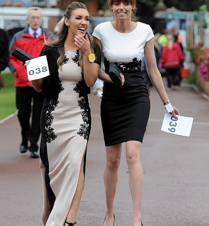 Racegoers arrive for Ladies Day during Day Two of the 2014 Welcome To Yorkshire Ebor Festival at York Racecourse, York