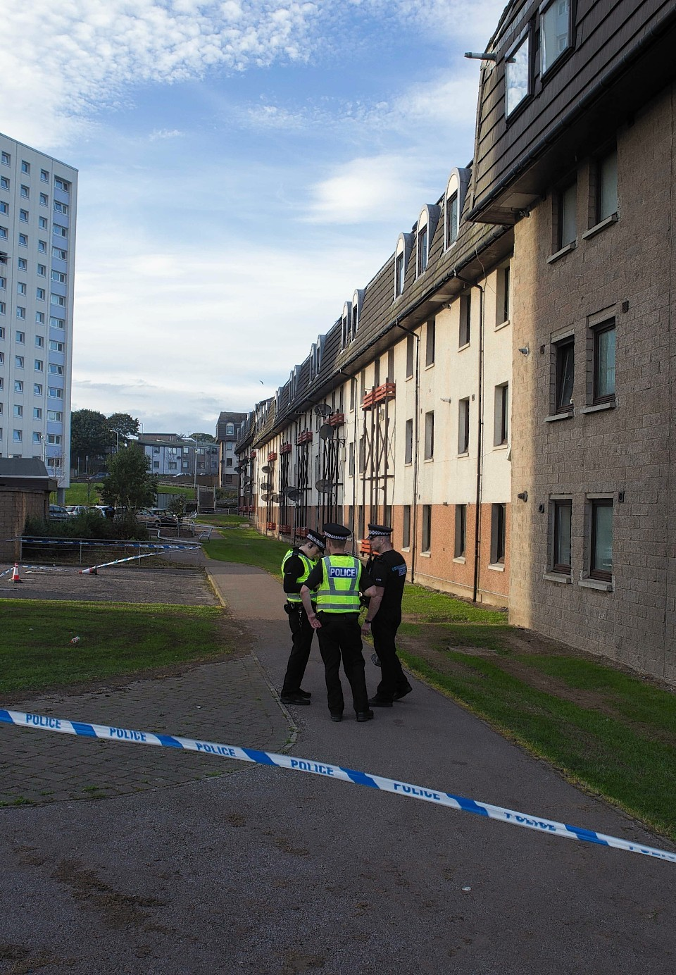 Police and forensics officers outside the flat on Balnagask Avenue, Aberdeen