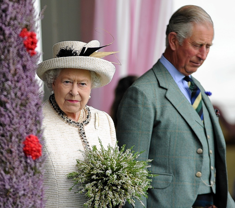 The Queen and Prince Charles attend the Braemar Gathering. Credit:  Kami Thomson.
