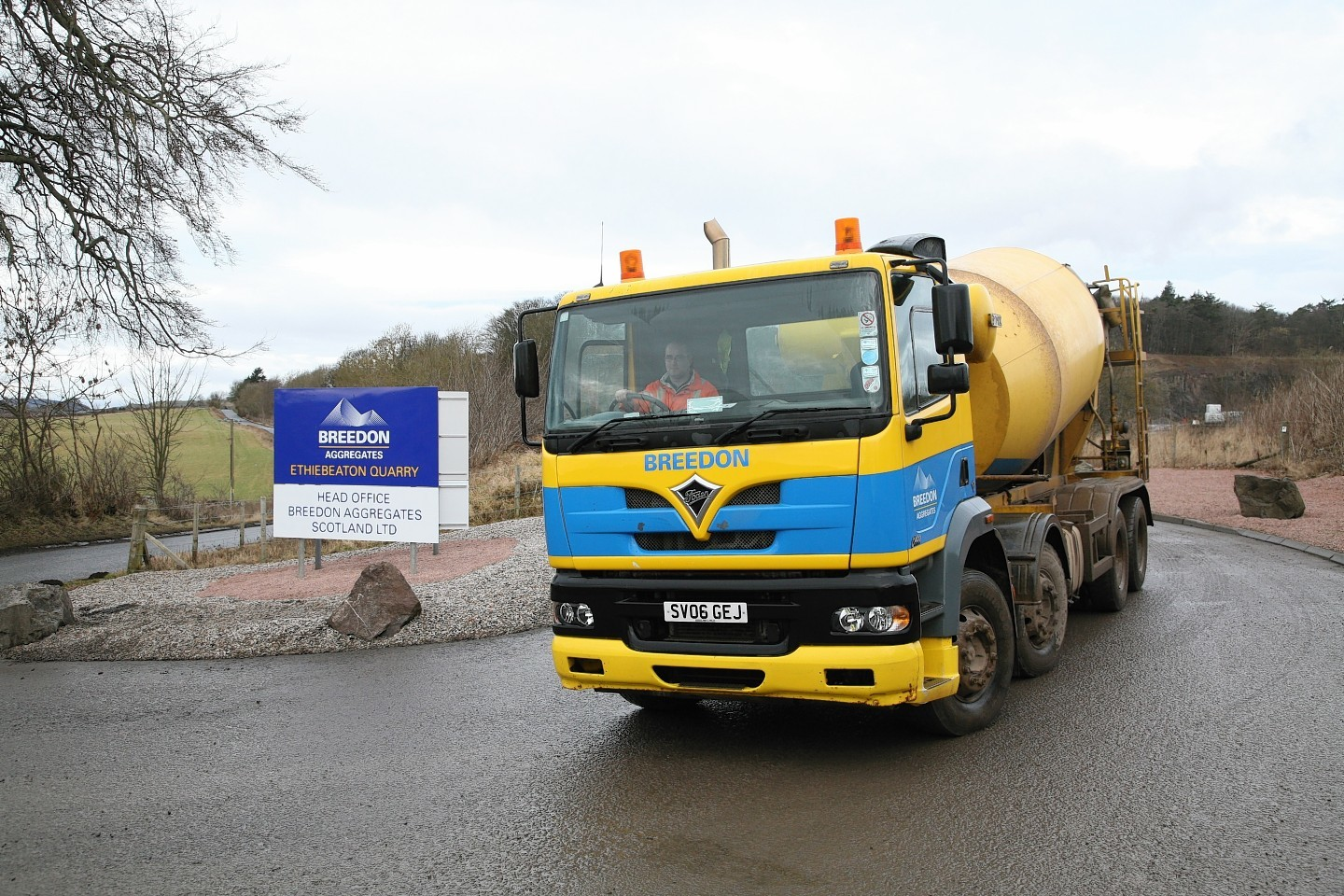 A cement mixing lorry leaving at Breedon Aggregates owned quarry
