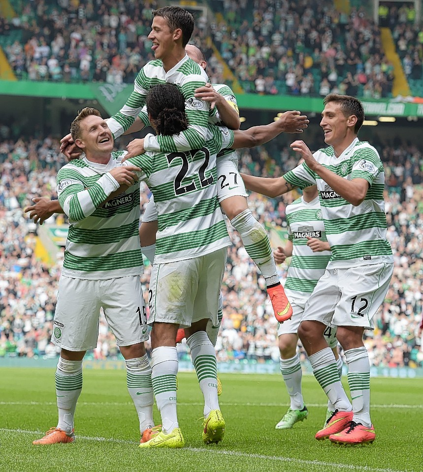 Celtic players mob Denayer after he opened the scoring