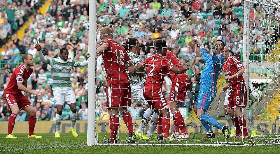 Celtic defender Jason Denayer bundles home the opening goal