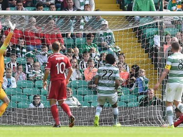 David Goodwillie stoops to pull a goal back for the Dons