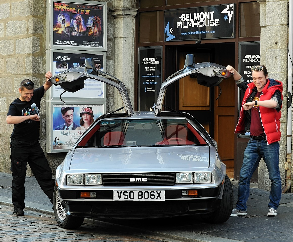 The DeLorean with its owner, Paul Mackie, and Belmont Filmhouse marketing and events manager, Dallas King, outside the cinema. Credit: Jim Irvine.
