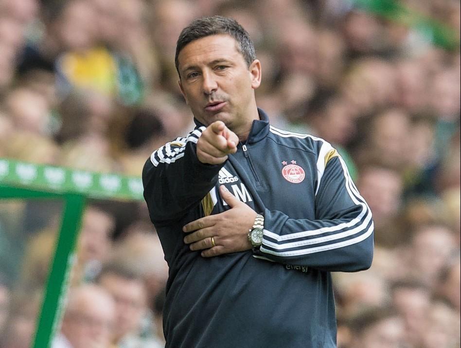 Derek McInnes has taken his Dons team to the top of the Premiership table