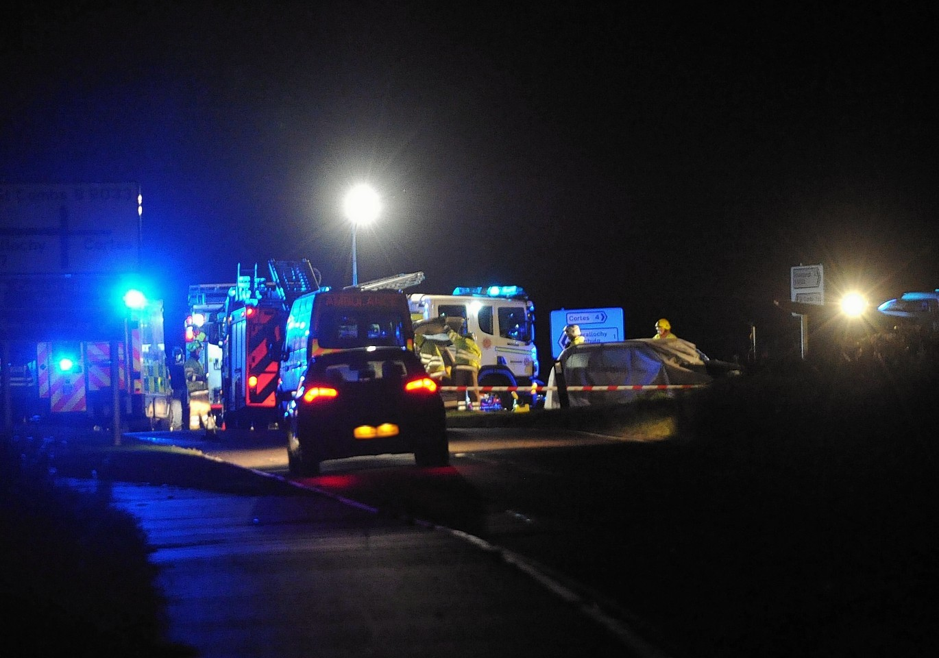 Emergency vehicles at the scene of the crash. Credit: Duncan Brown.