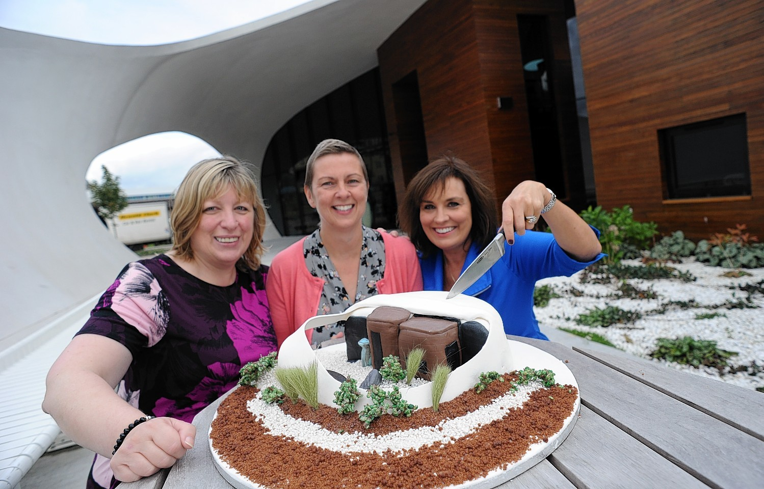 Susan Sutherland, Lyndsey Hope and Patricia Straughen with Mrs Hope's cake