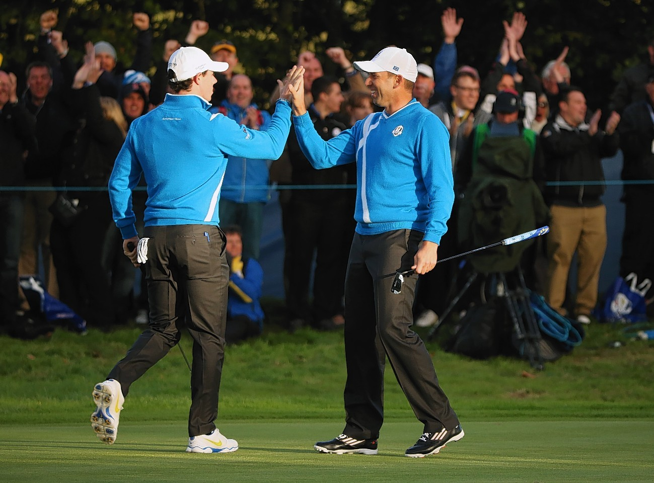 McIlroy and Garcia won their last two holes to half their match this afternoon