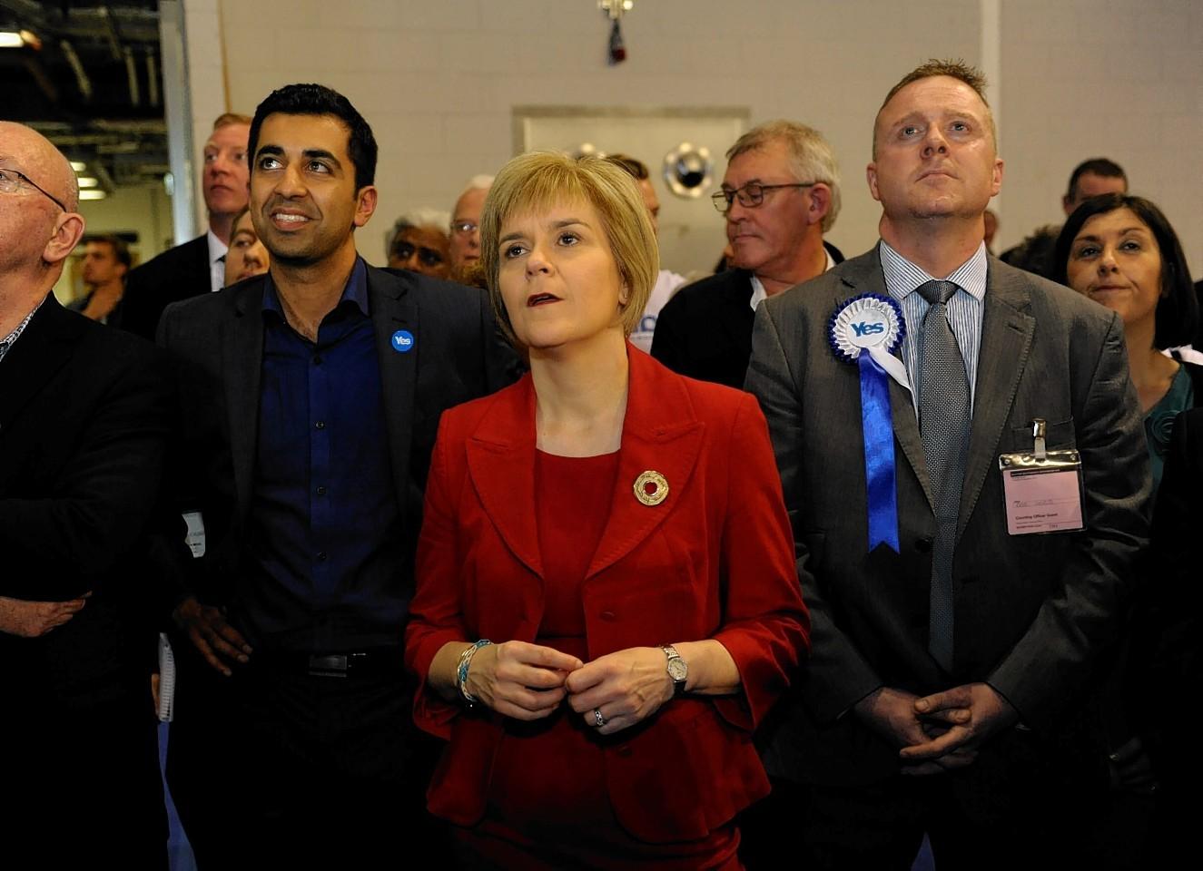 Nicola Sturgeon in red