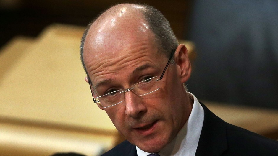 Finance Secretary John Swinney is one of two SNP appointments to devolution commission.
