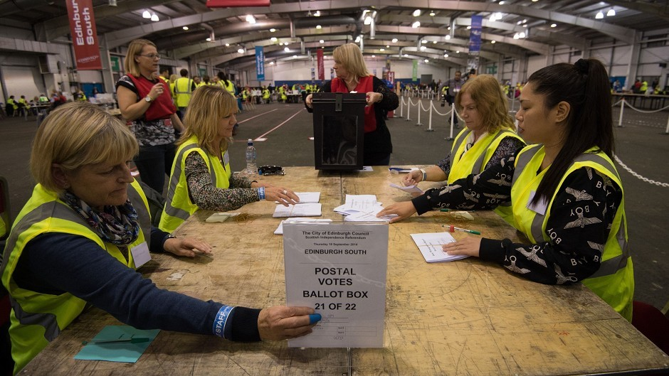 Volunteers begin to count the first postal ballots returned for the Scottish referendum at Highland Hall in Ingliston