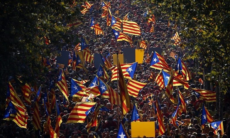 A demonstration calling for the independence of Catalonia marches in Barcelona.