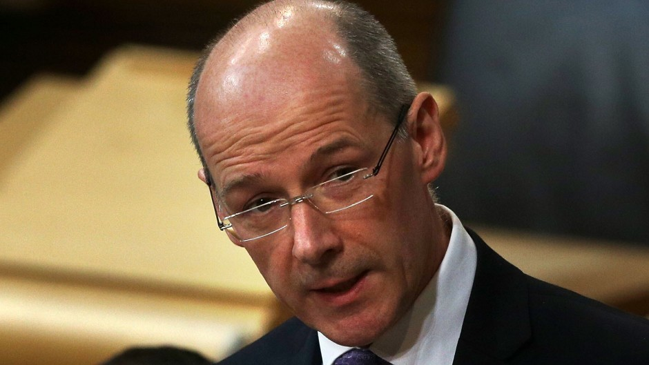 Deputy First Minister John Swinney said budget means Scotland will continue to pay the price of UK austerity.
