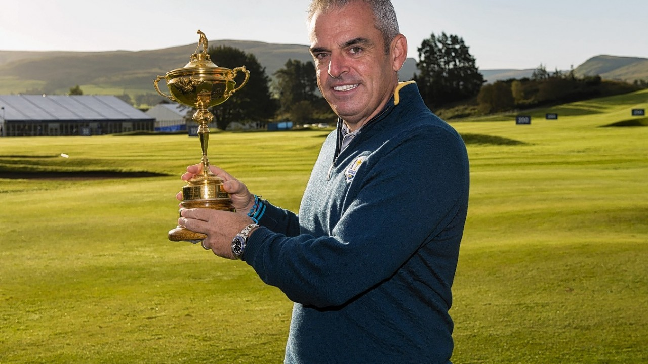 Paul McGinley gets an early touch of the trophy