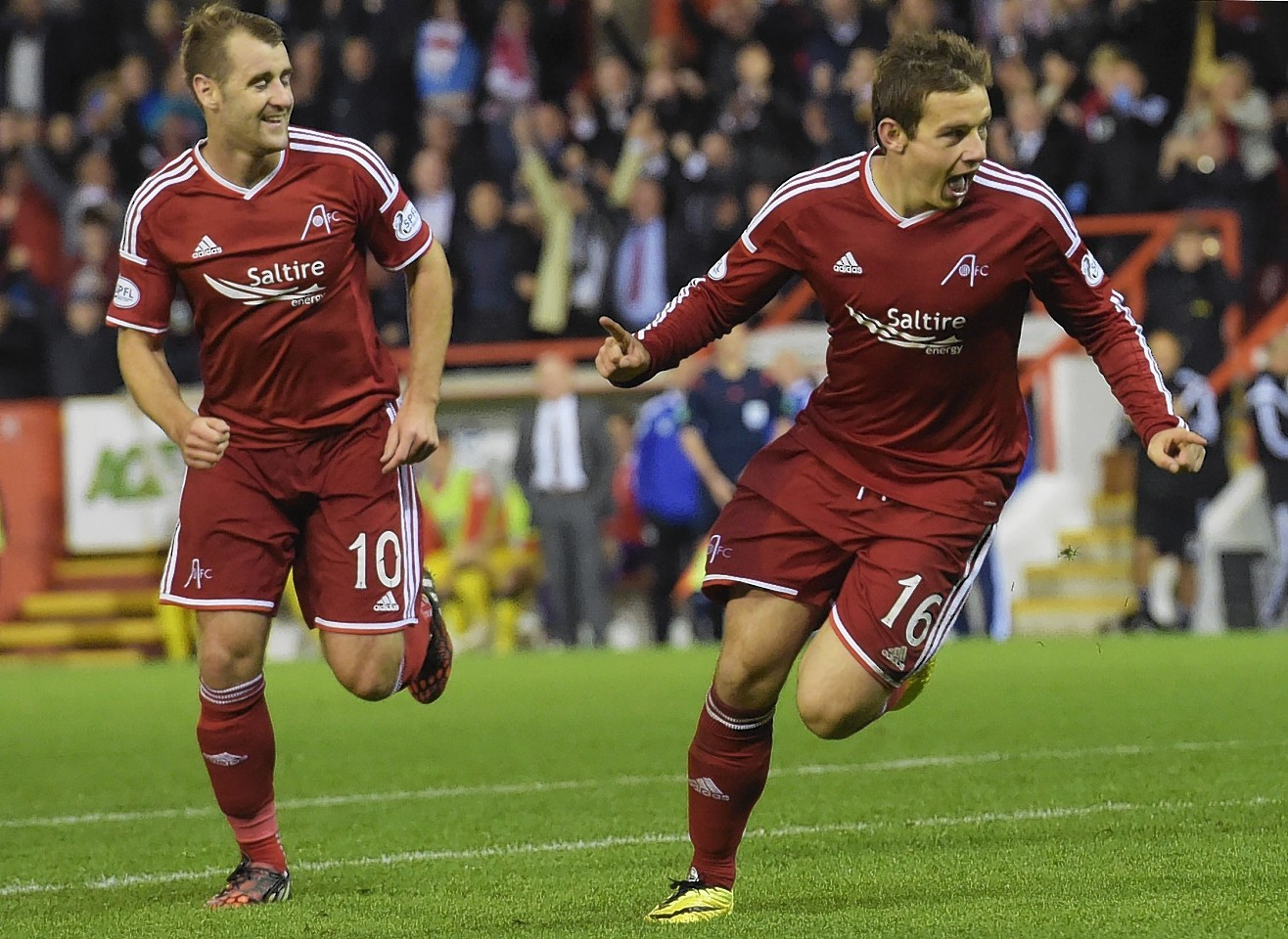 Peter Pawlett celebrates giving Aberdeen a 2-0 lead