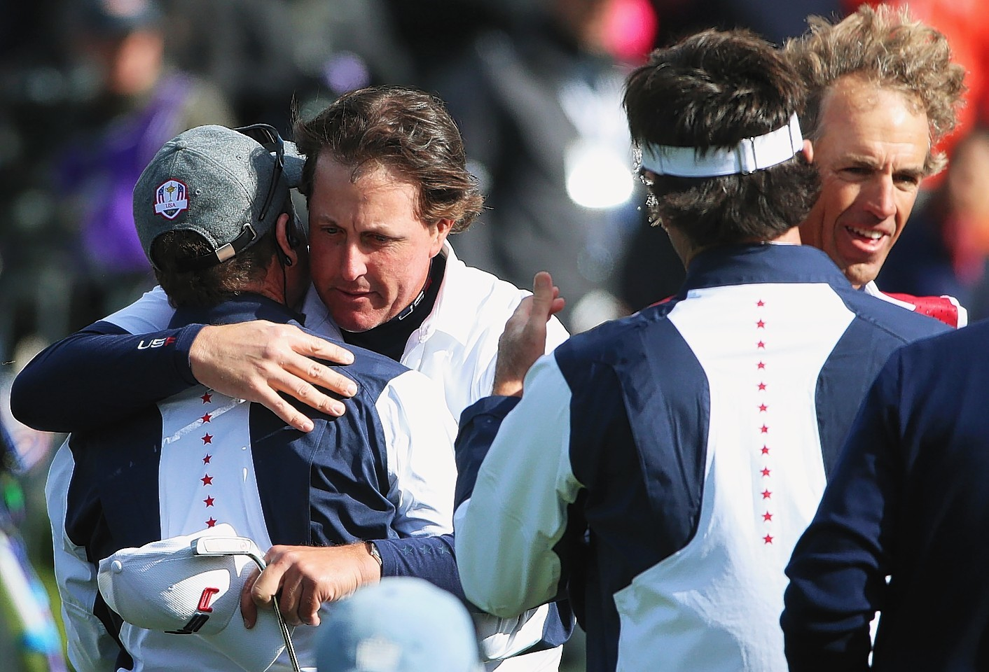 American Phil Mickelson embraced his team mates after he and Bradley defeated McIlroy and Garcia