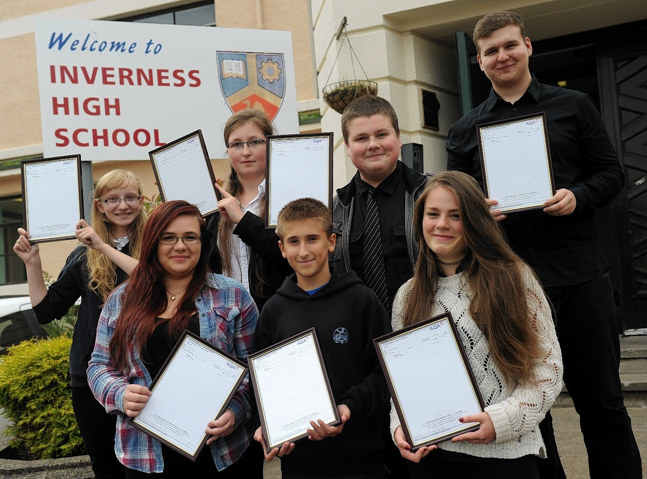 Polish students show off their results outside Inverness High School