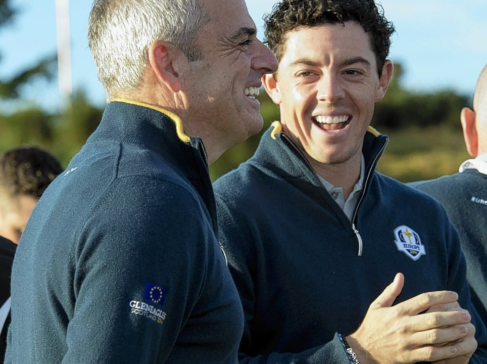 World number one Rory McIlroy shares a joke with captain McGinley