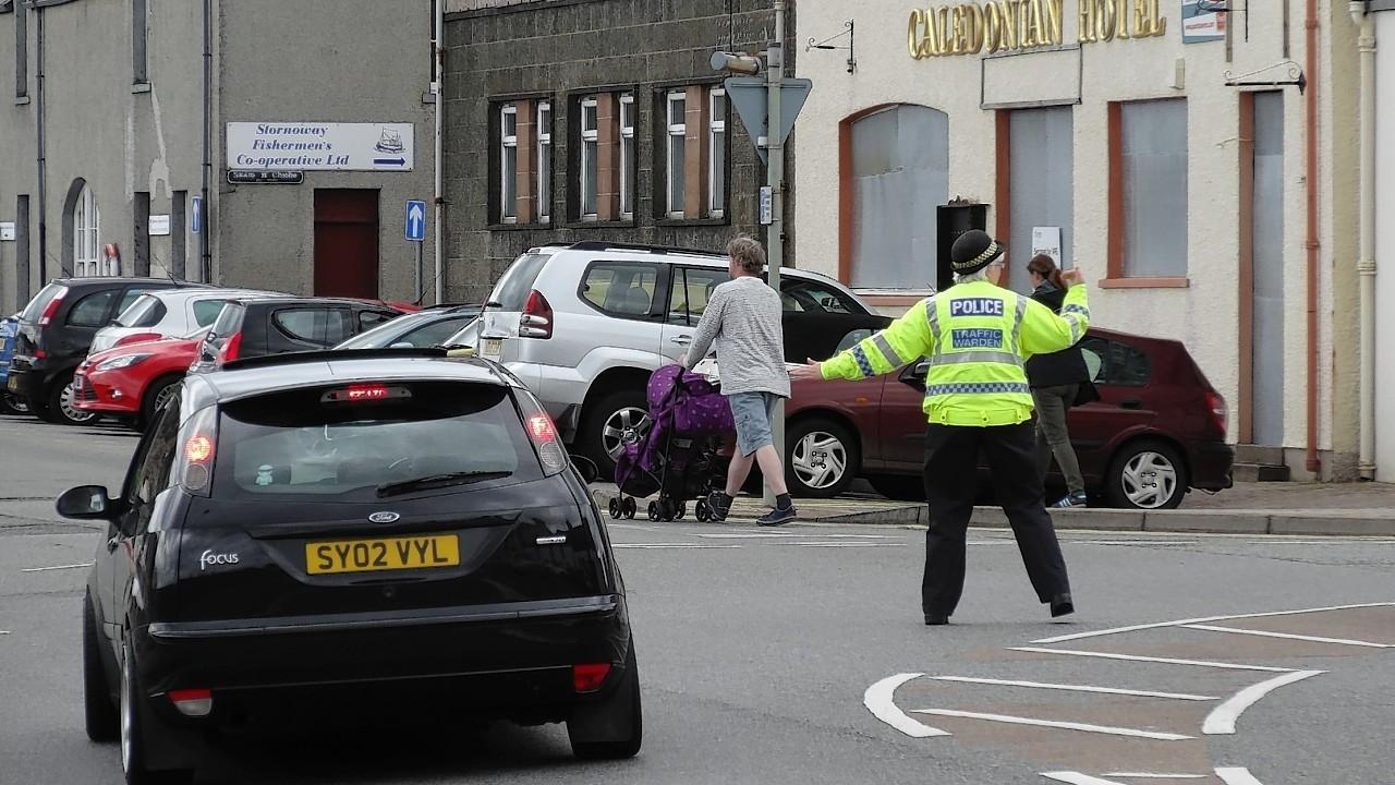 Stornoway's lone traffic warden in action