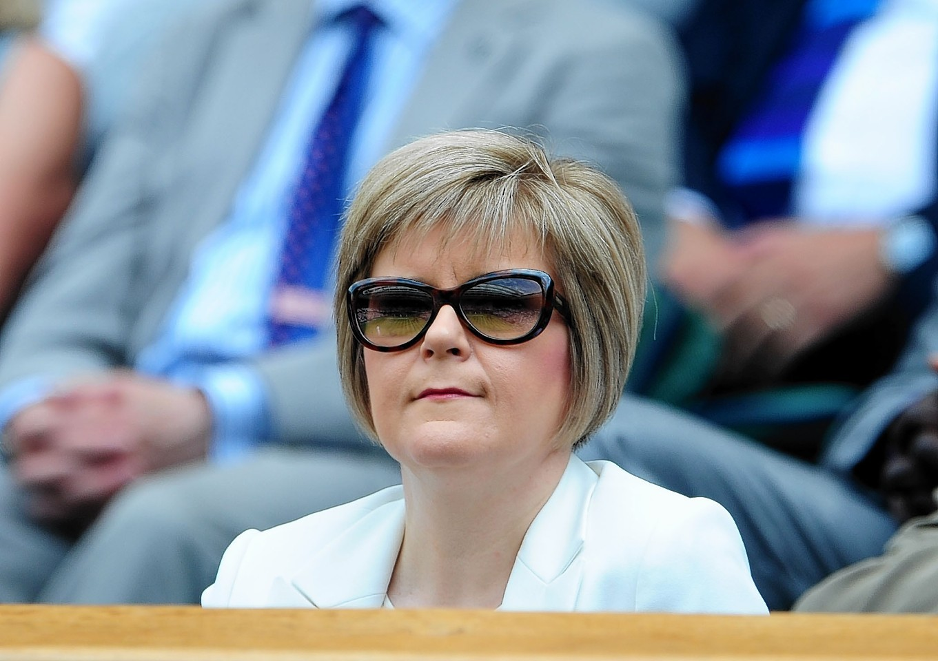 Stylish: Sturgeon is a fan of heels, shades and suits but admits she prefers lounging about in jeans