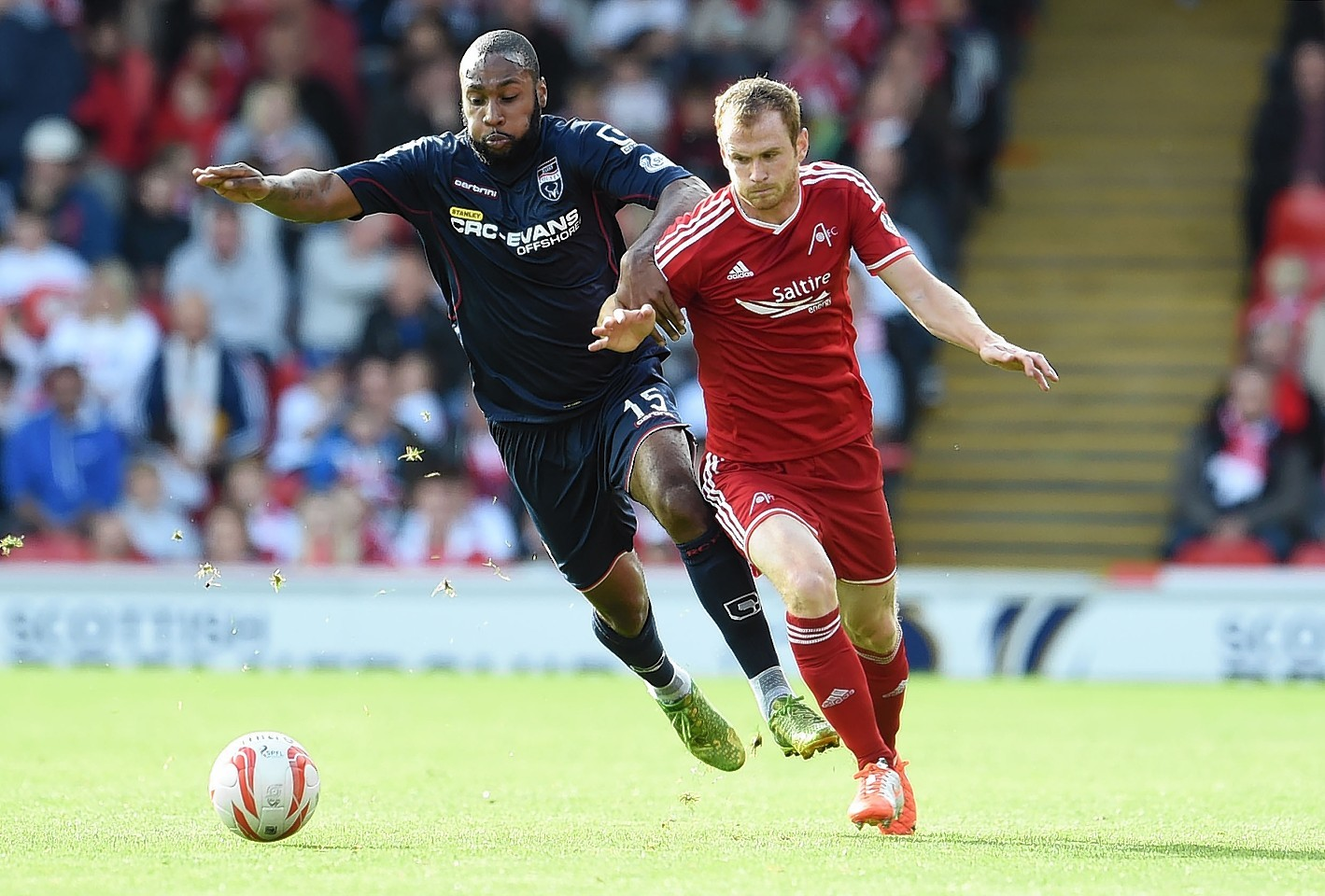 Yoann Arquin fights for the ball against the Dons