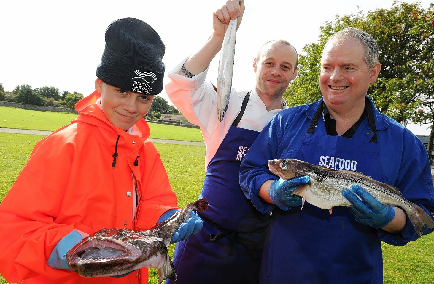 Seafood in Schools roadshow at Mackie Academy. Cameron Carnie, 12,  with chef David Morrison and skipper Peter Bruce