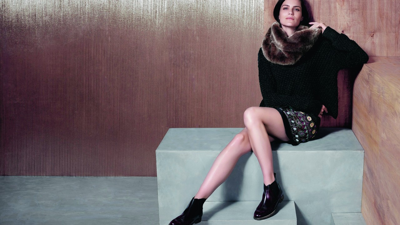 Delphine embellished skirt, £69; knit jumper, £49; faux fur snood, £35; Chelsea boots, £79; all Monsoon