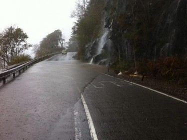 A river of water runs across the A82.