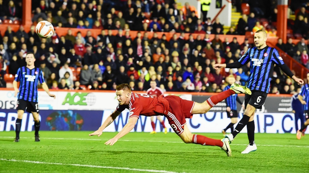 Adam Rooney dives to head home the only goal of the game.
