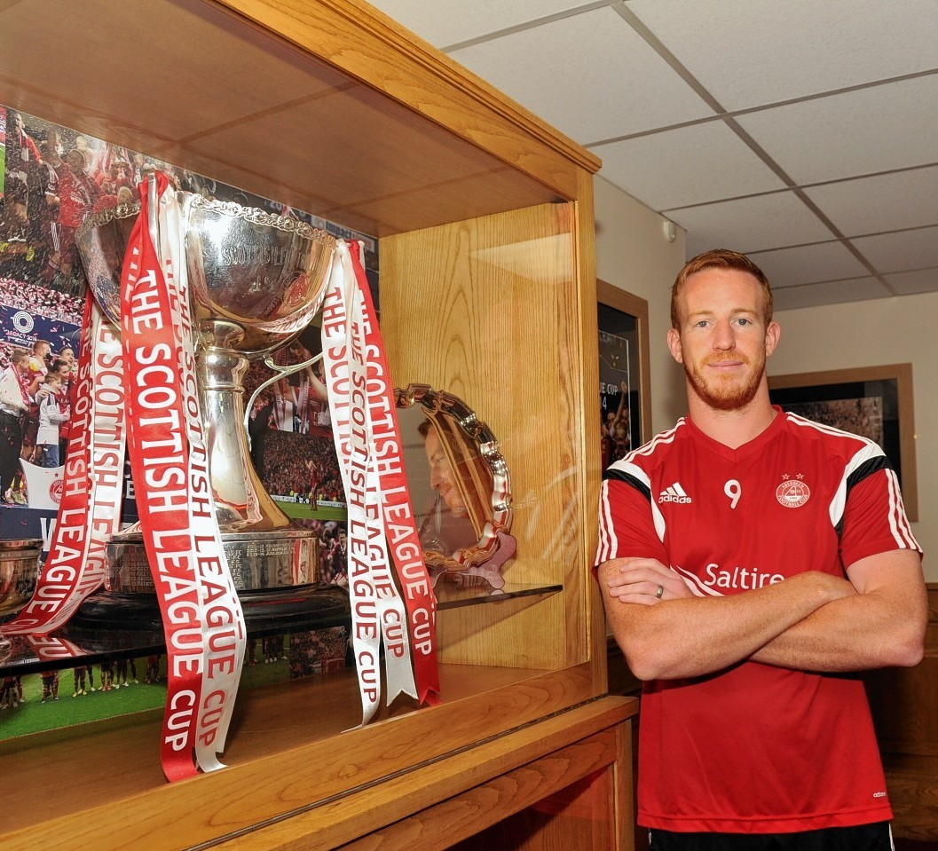 Adam Rooney hopes Aberdeen can retain the League Cup but for now they are focused on league duty against Motherwell