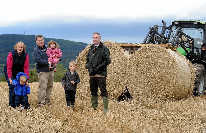The Bennie family with farm minister Richard Lochhead