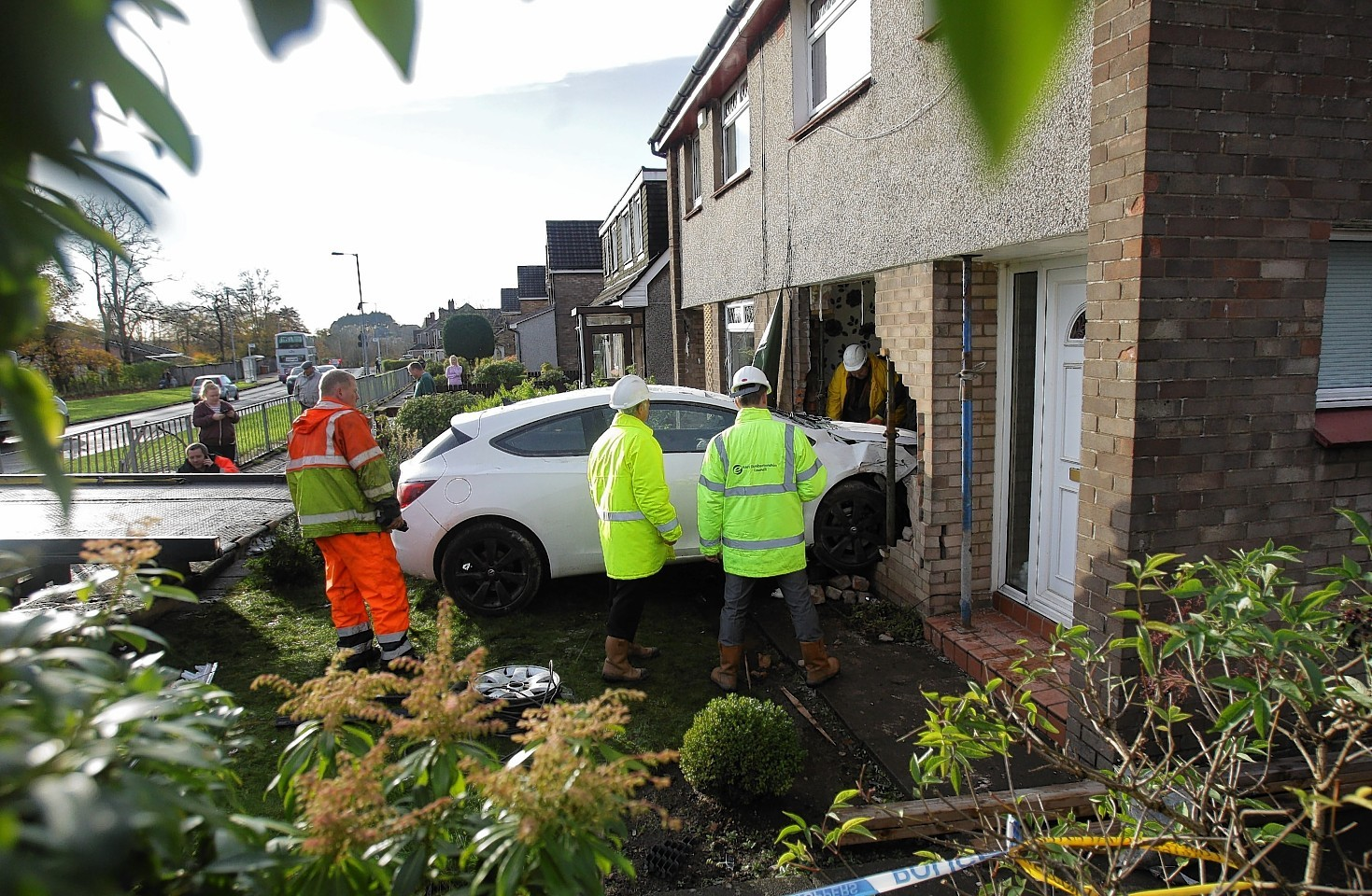 The car crashed straight through the wall of the house