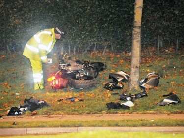 A police officer investigates the shattered Kawasaki following the crash near Altens