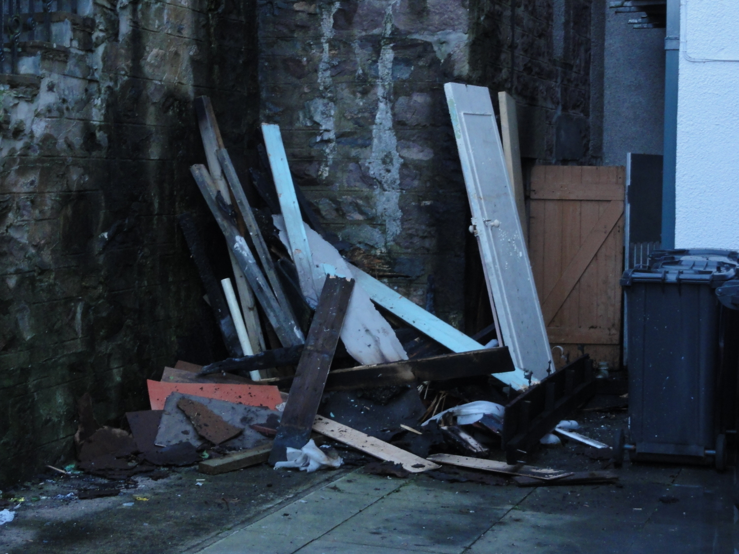 Debris piled up against the external wall of the torched building. Picture by Murdo Maclean.