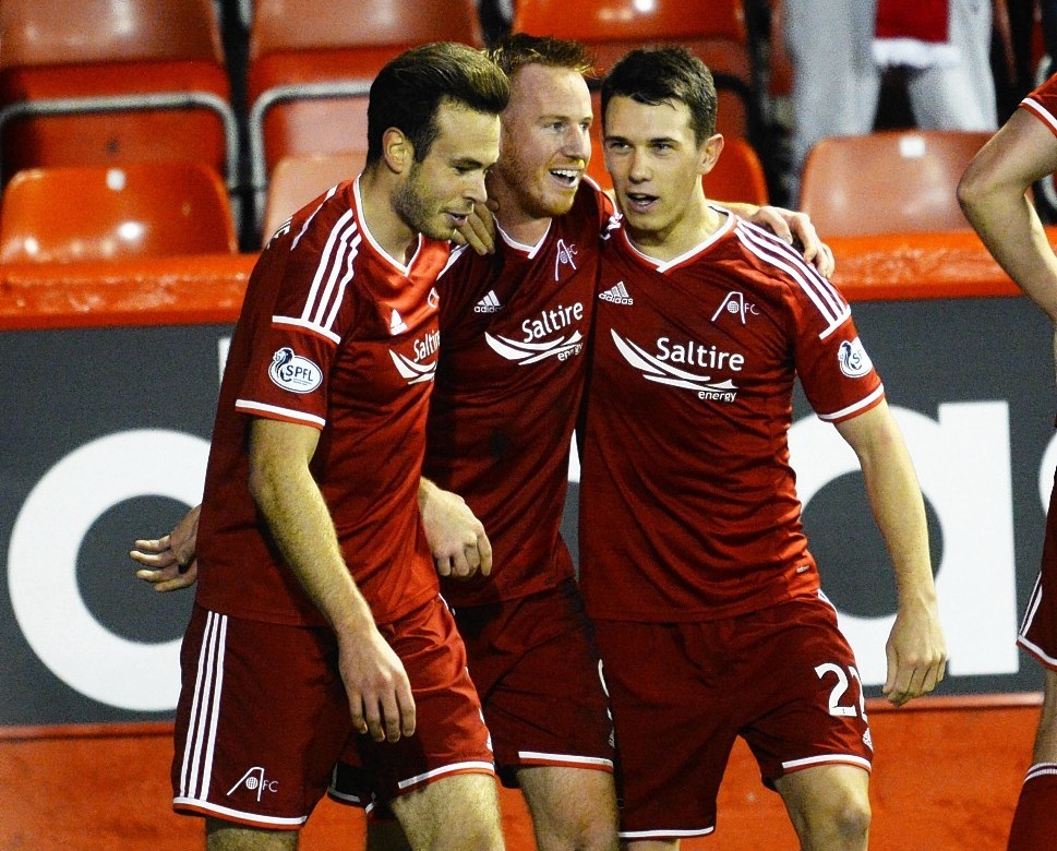 The Dons celebrate the only goal of the game